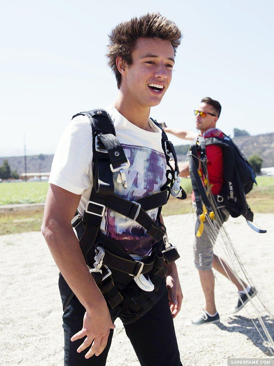 Happy Cameron Dallas in harness.