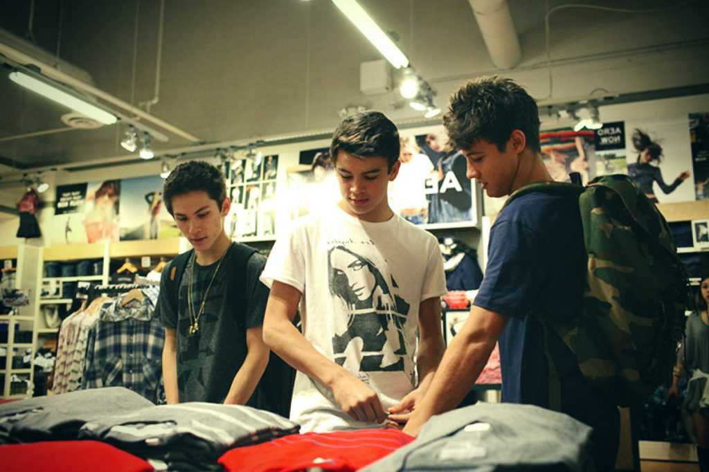 Cameron, Hayes and Carter admire shirts.