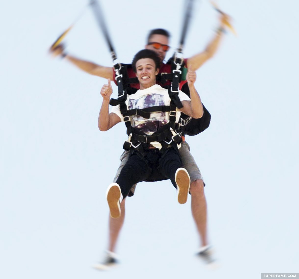 Cameron Dallas parachuting.