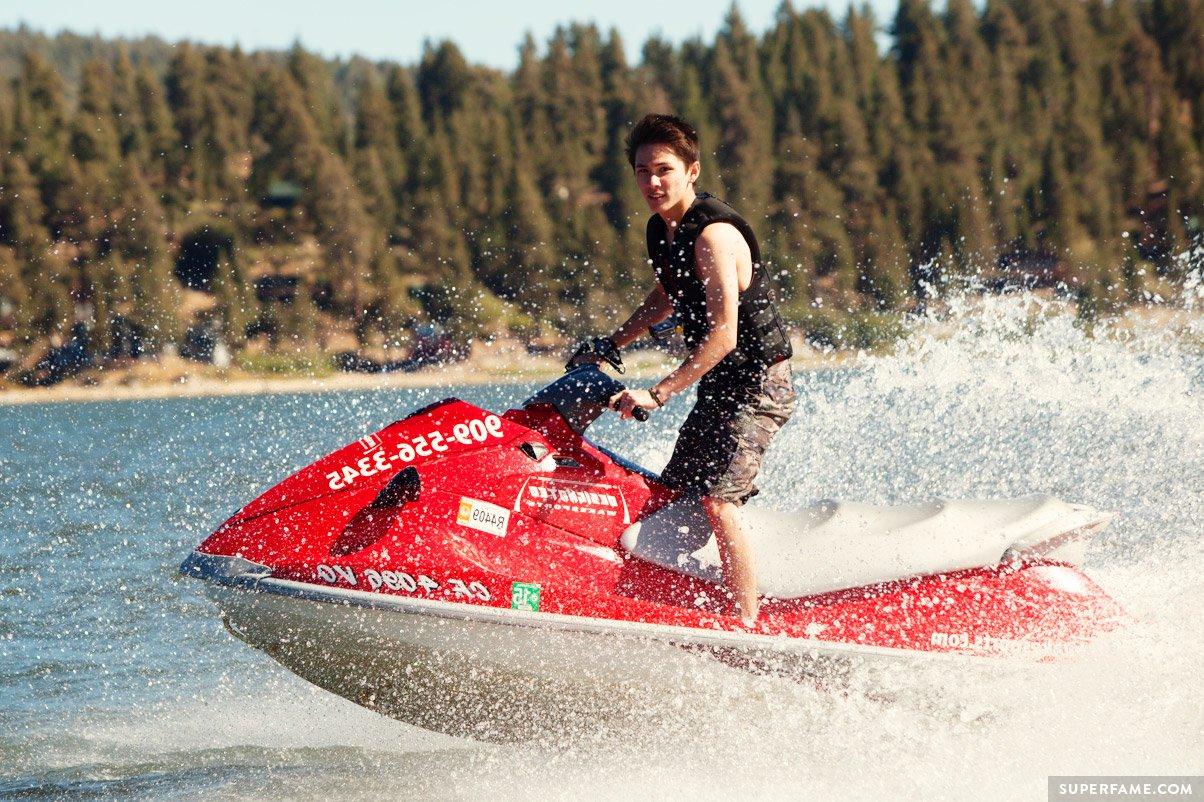 Carter Reynolds rides a red jetski.