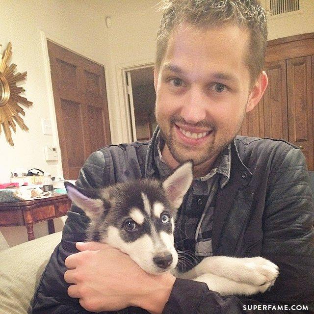 Luke Conard with Joey Graceffa's dog Wolf.