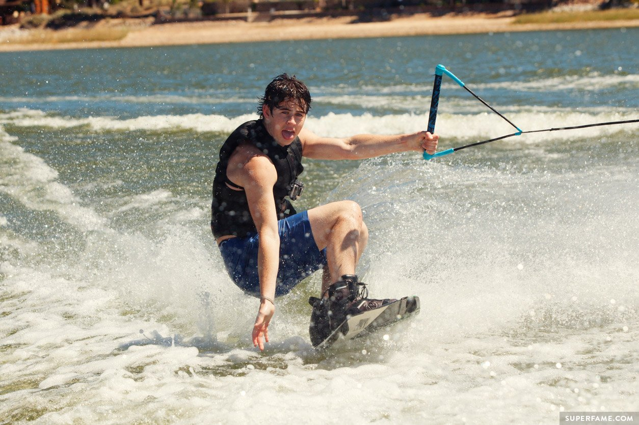 Nash Grier wakeboarding in water.