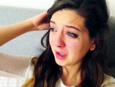 Zoella is crying.