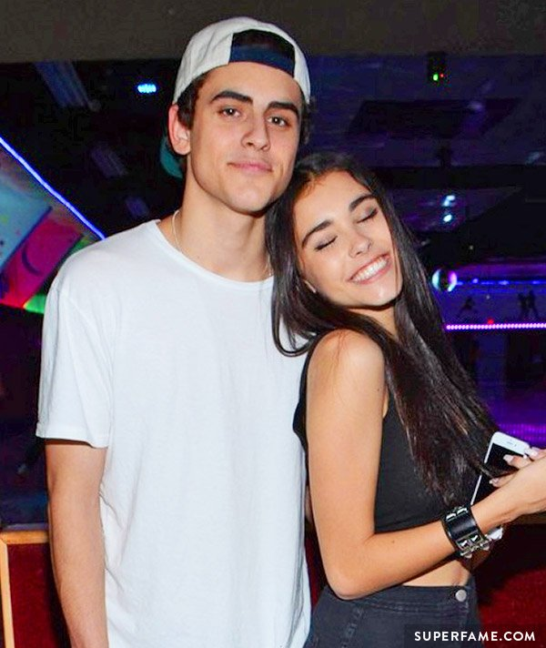 Madison Beer leans into Jack Gilinsky at a party.