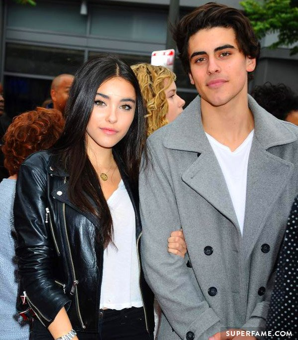 Madison Beer holds onto Jack Gilinsky.