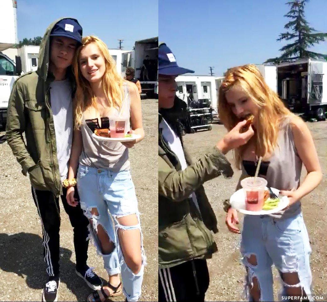 Kian Lawley feeds Bella Thorne.