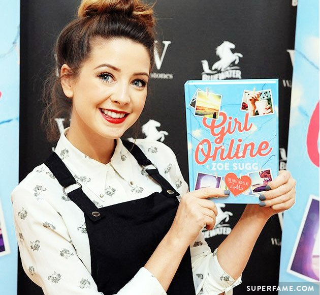 Zoella with a copy of Girl Online.