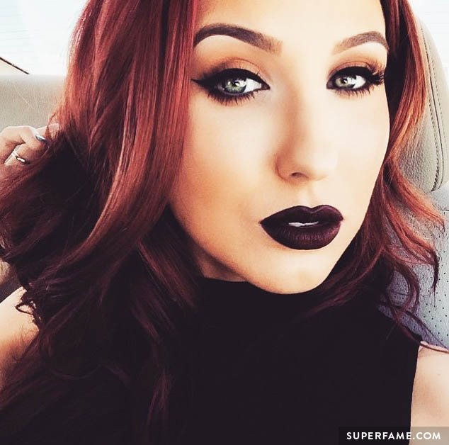 Jaclyn Hill shows off dark lipstick.
