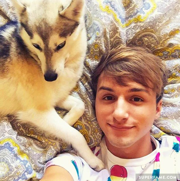 Lucas Cruikshank hangs out with a dog.
