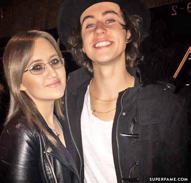 Stalker Sarah poses with Nash Grier outside.