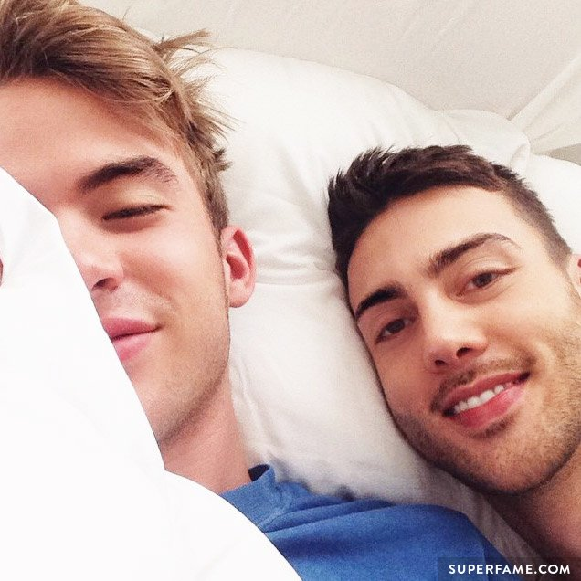 Aaron Rhodes in bed with Travis Bryant.