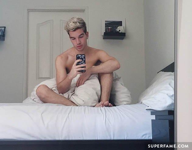 Drew MacDonald shirtless in bed.