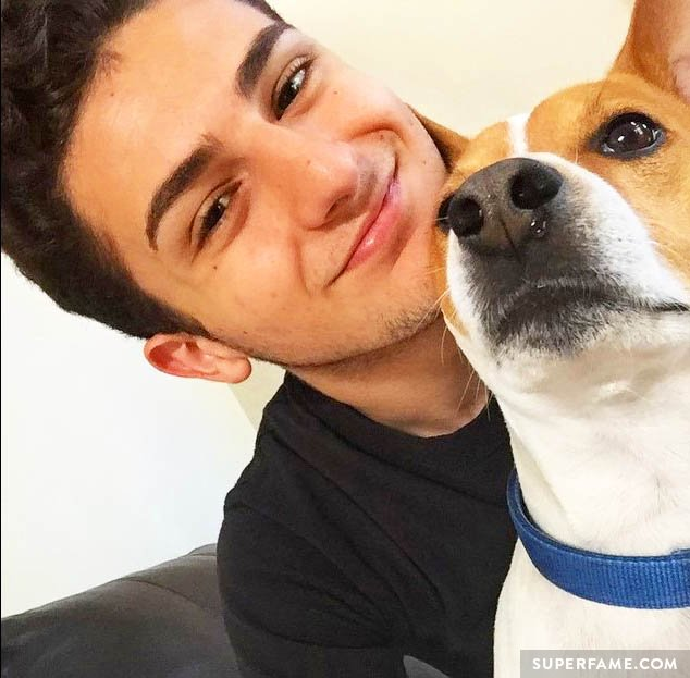 Twaimz smiling with a dog.
