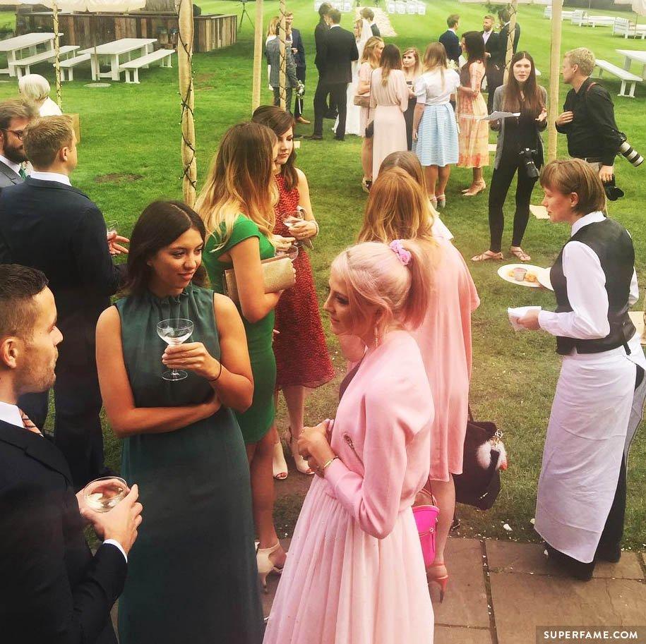 Wedding guests talking.