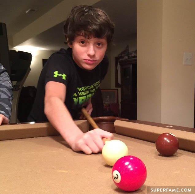 Caleb plays pool.