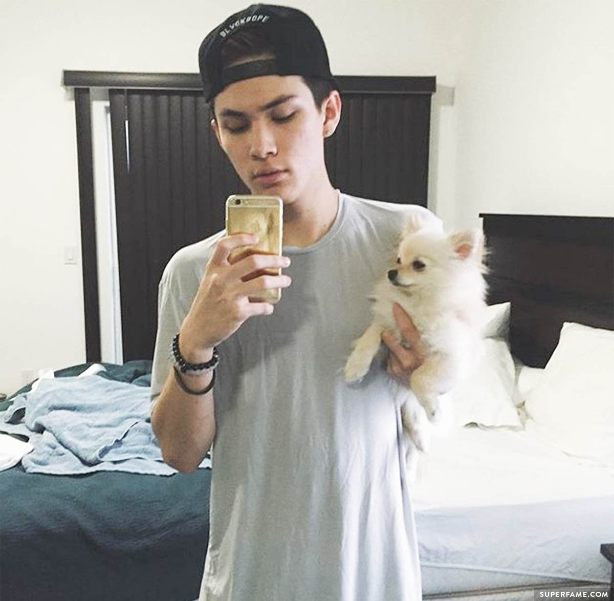 Carter Reynolds holds a dog.