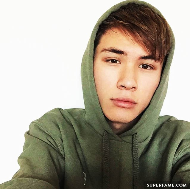 Carter in a green hoodie.