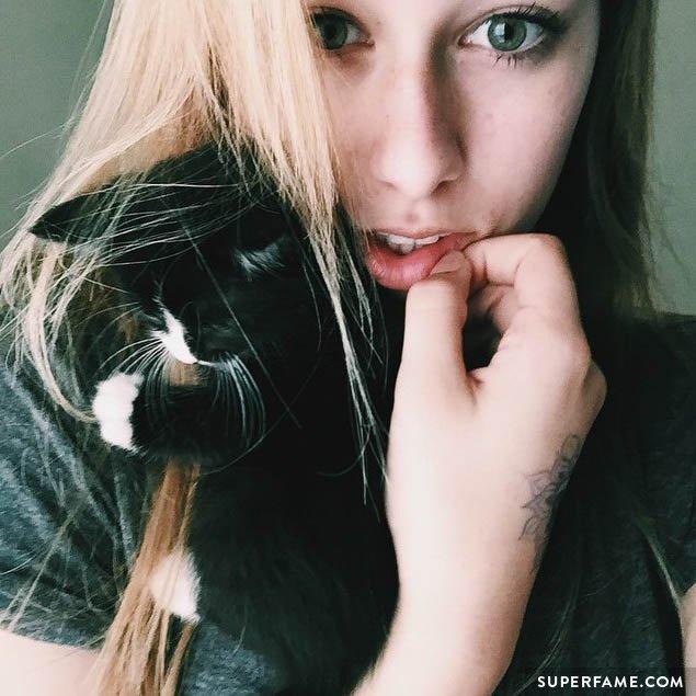 Maddie Welborn with a cat.