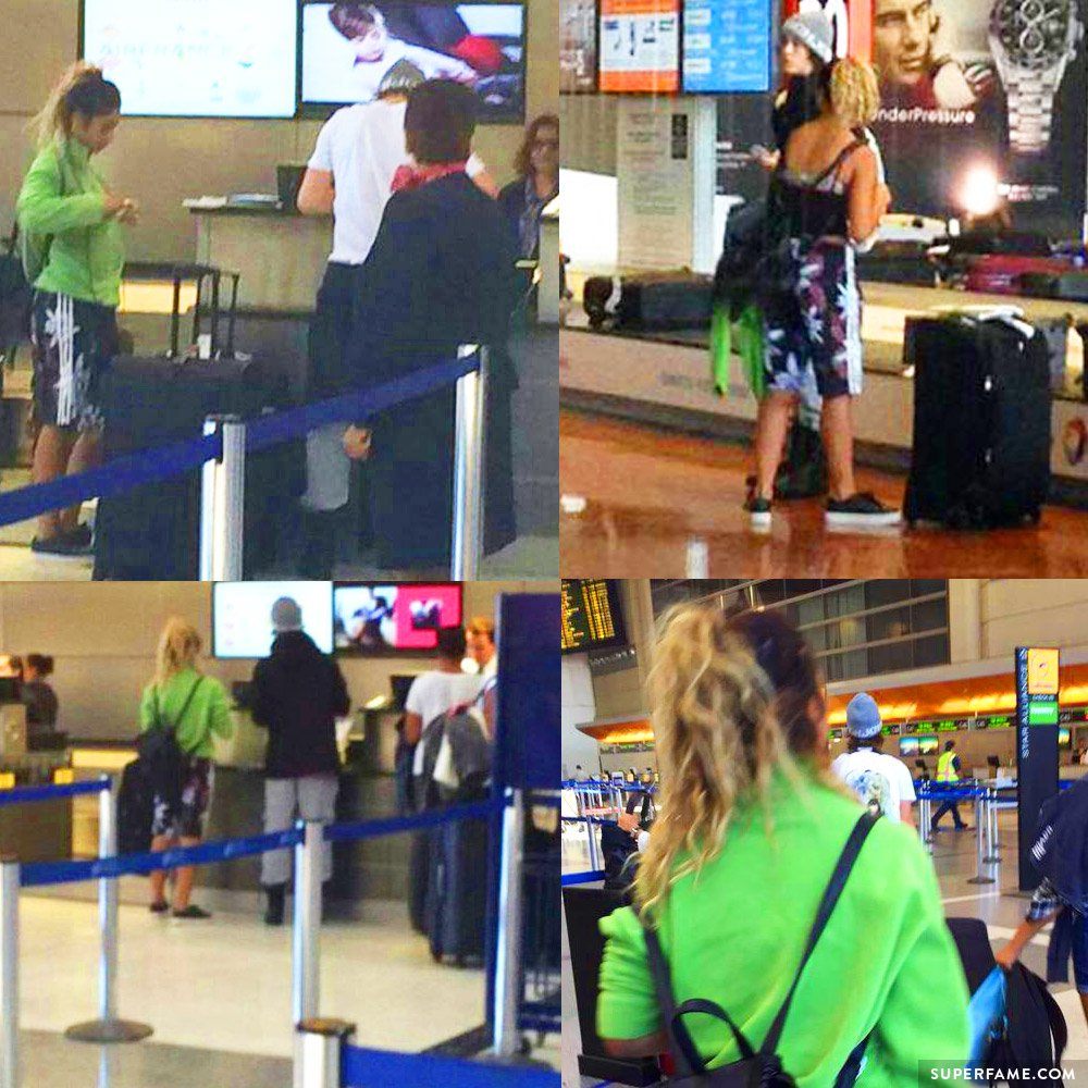 Fans follow Nash and Taylor around the airport.