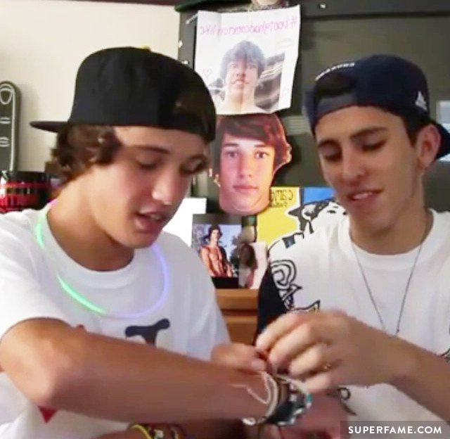 Cameron and Chris admire their bracelets.