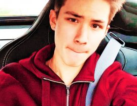 Carter Reynolds sitting in a car.