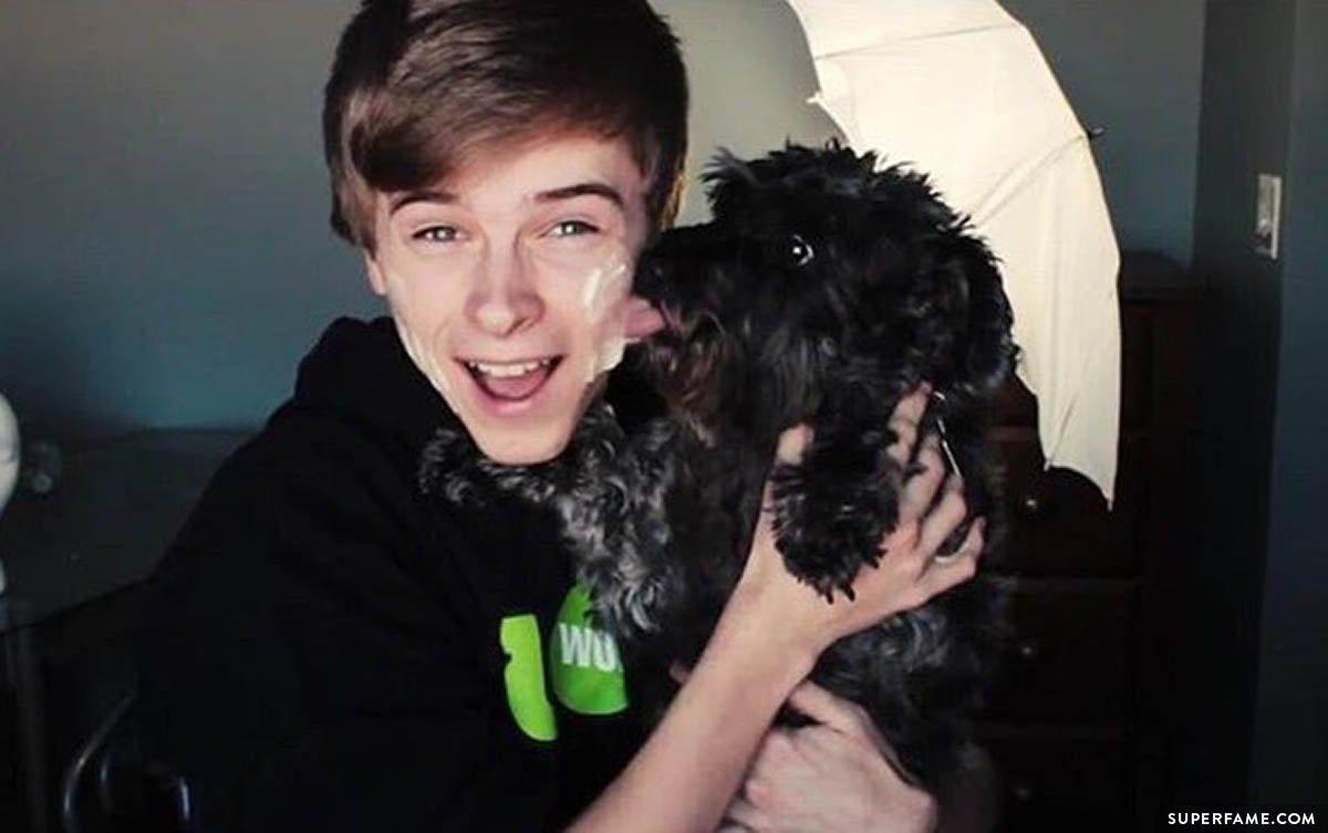 Luke Korns and a dog.