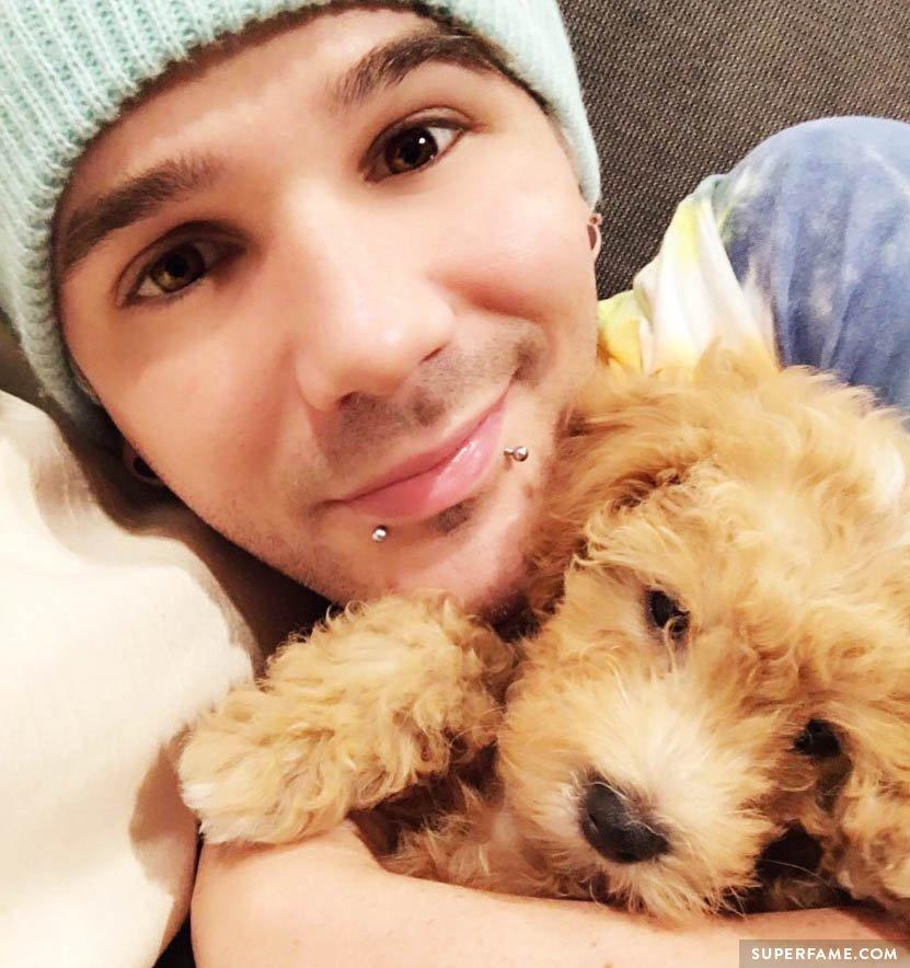 Matthew Lush and a dog.