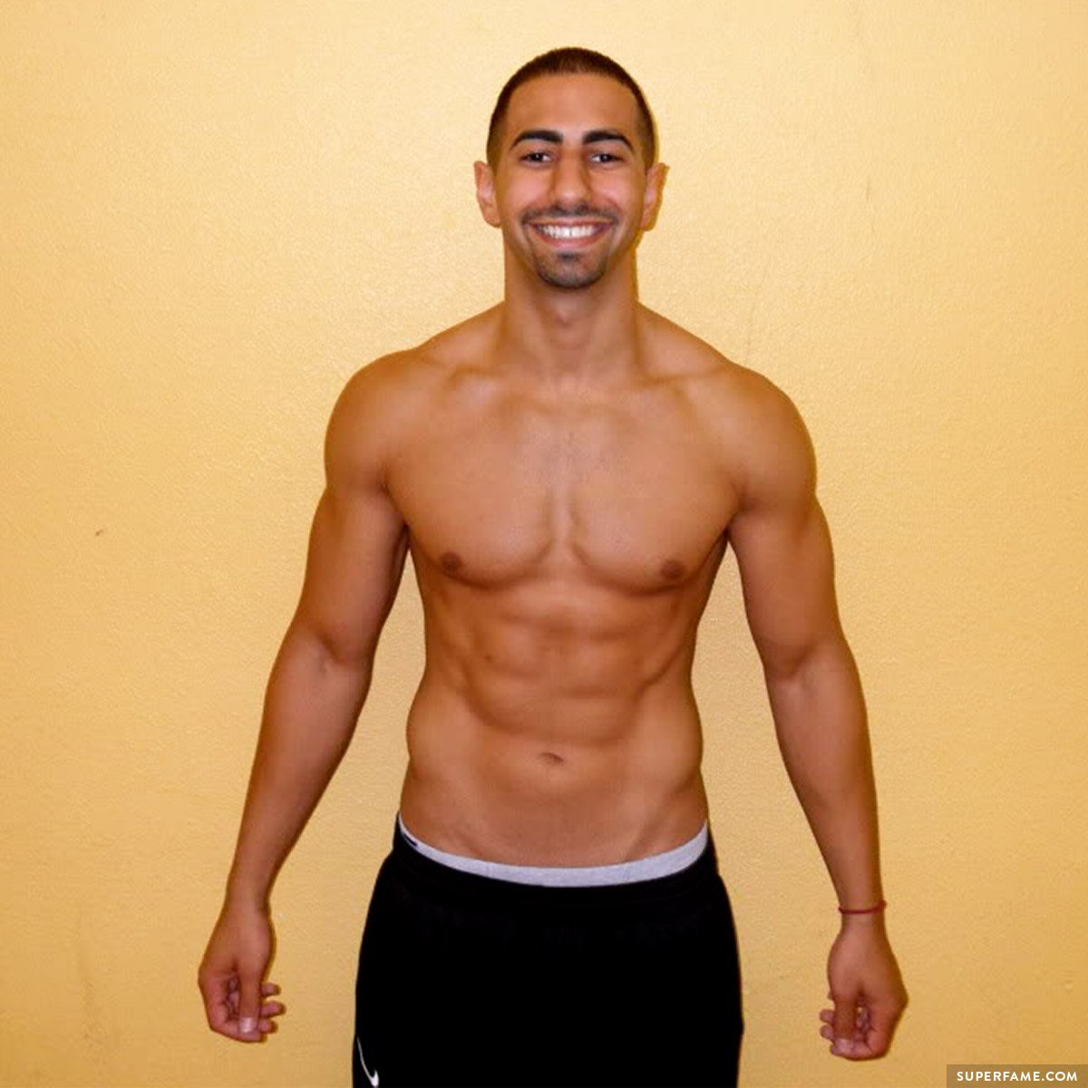 Yousef Erakat's shirtless body.