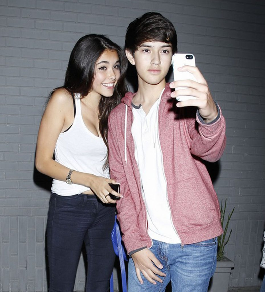 Madison Beer with a fan.