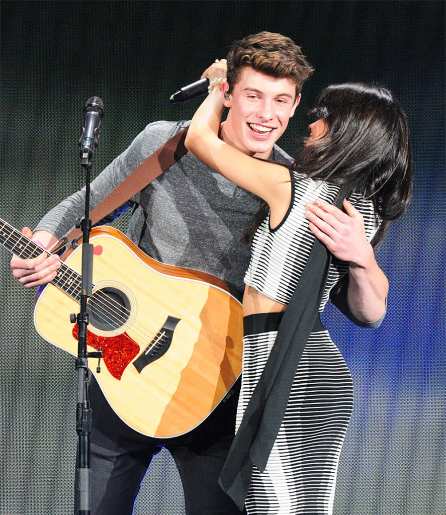Camila hugs Shawn.