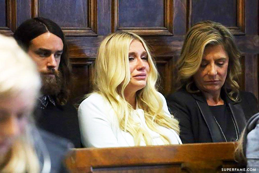 Kesha is crying.