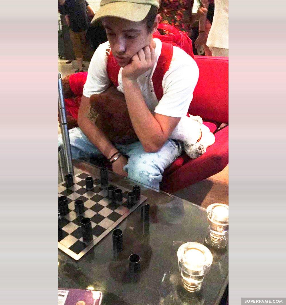 Cameron Dallas plays chess / checkers.