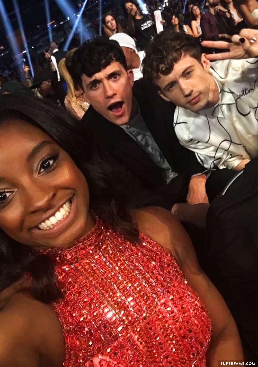 Simone Biles, Troye and Jacob.
