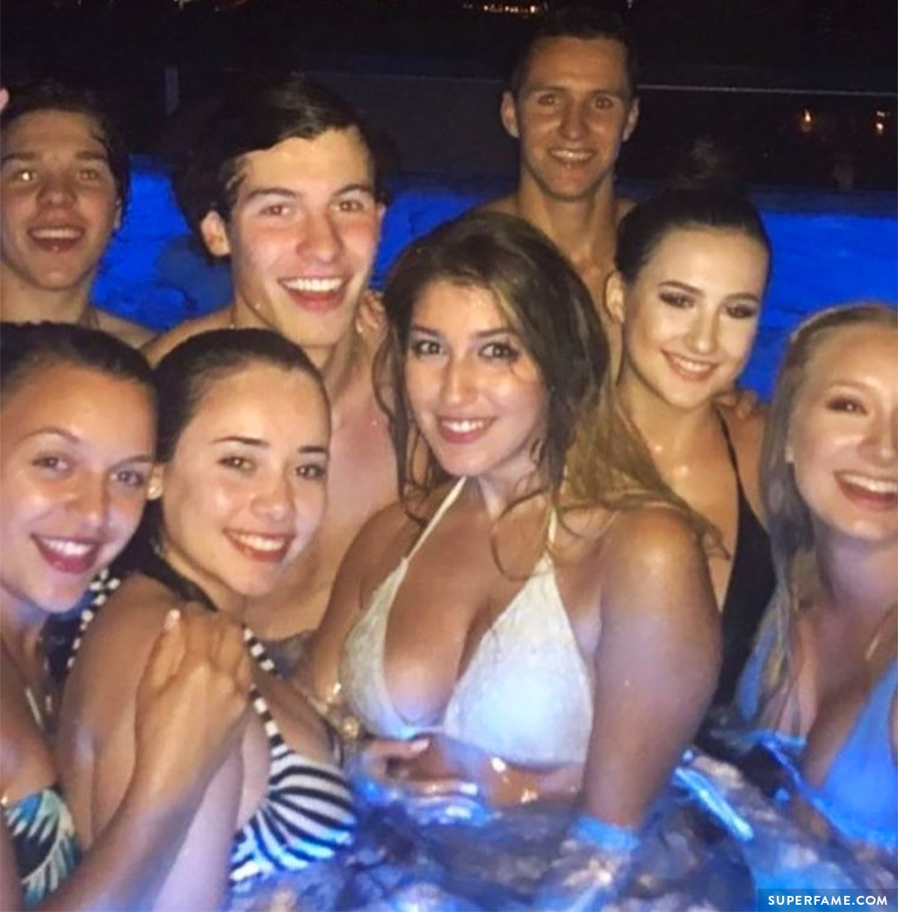 Shawn Mendes with girls in a pool.