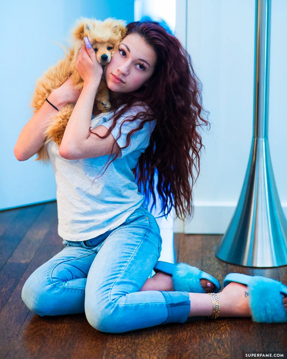 Bhad Bhabie with a puppy.